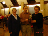 Alaric presents the trophy to a delighted Anne and Irene